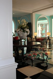 Minty green walls and floral upholstery -- color at The Greenbrie