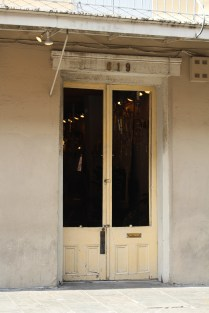 Long windows add depth to this charming door in French Quarter
