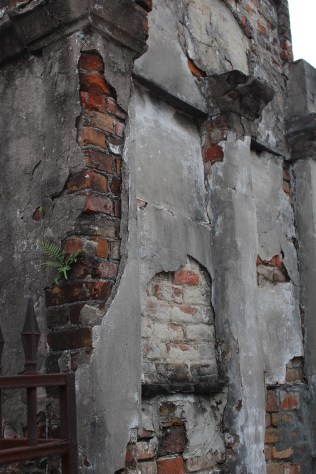 Remnants of plaster and brick at St. Louis Cemetery 1