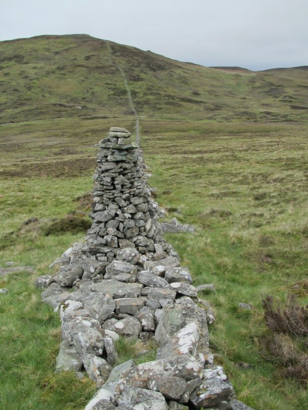 Cairn built from drystone wall on approach to Beinn a' Chuallaich