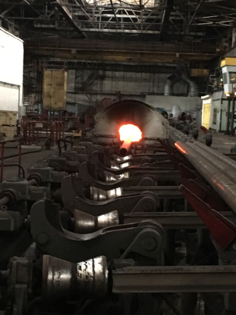 a quench and tempering heat treatment line for seamless OCTG and transport line pipe