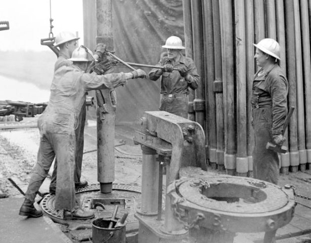 OILMAN ARCHIVE: Sometimes it takes an old pro to show the young roughnecks how it's done…1950s
