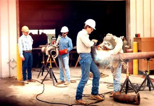 In 1988 BCCI employees prefabricate pipe spools at BCCI facility.