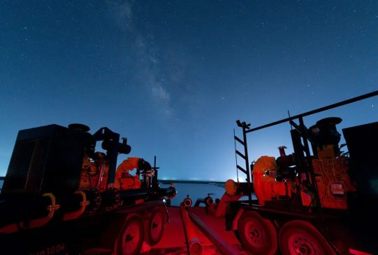 """""""Night Lights"""" The Milky Way and Lights from Fracking Operations Shine Over Water Transfer Pumps"""