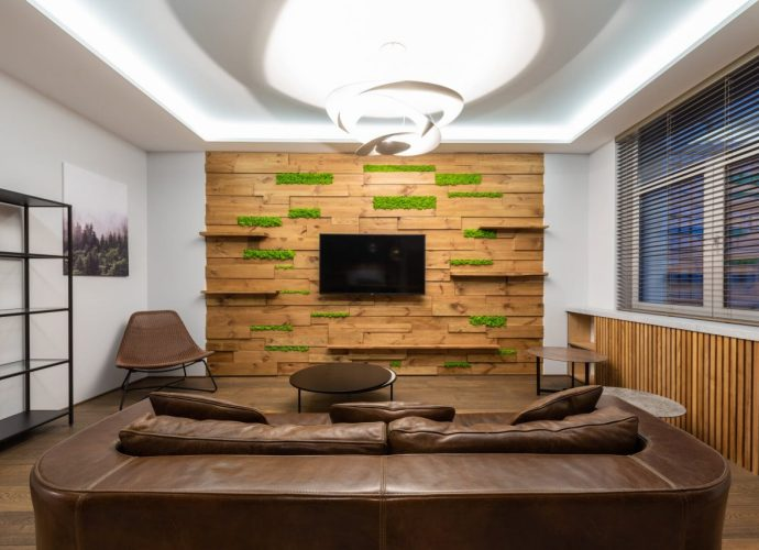 luxury lounge with leather sofa and tv hanging on wall