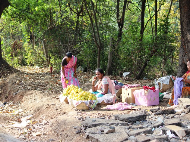 Village women with baskets full of food beckon road trippers to satiate their hunger
