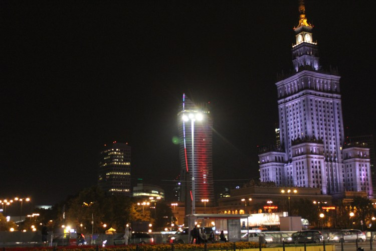 The tall buildings of Warsaw gleam at night