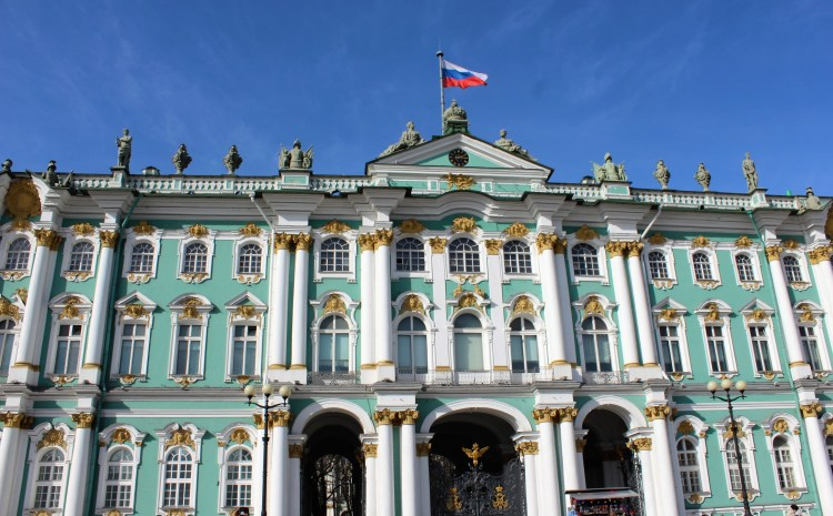 The Russian tricolour flutters atop the Winter Palace