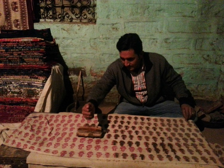 Block printing artist at work