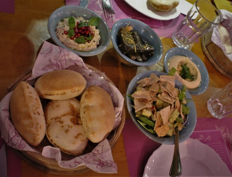 A vegetarian Emirati fare - Arabic bread, fattoush, baba ghanoush and mutabbal with some eggplant