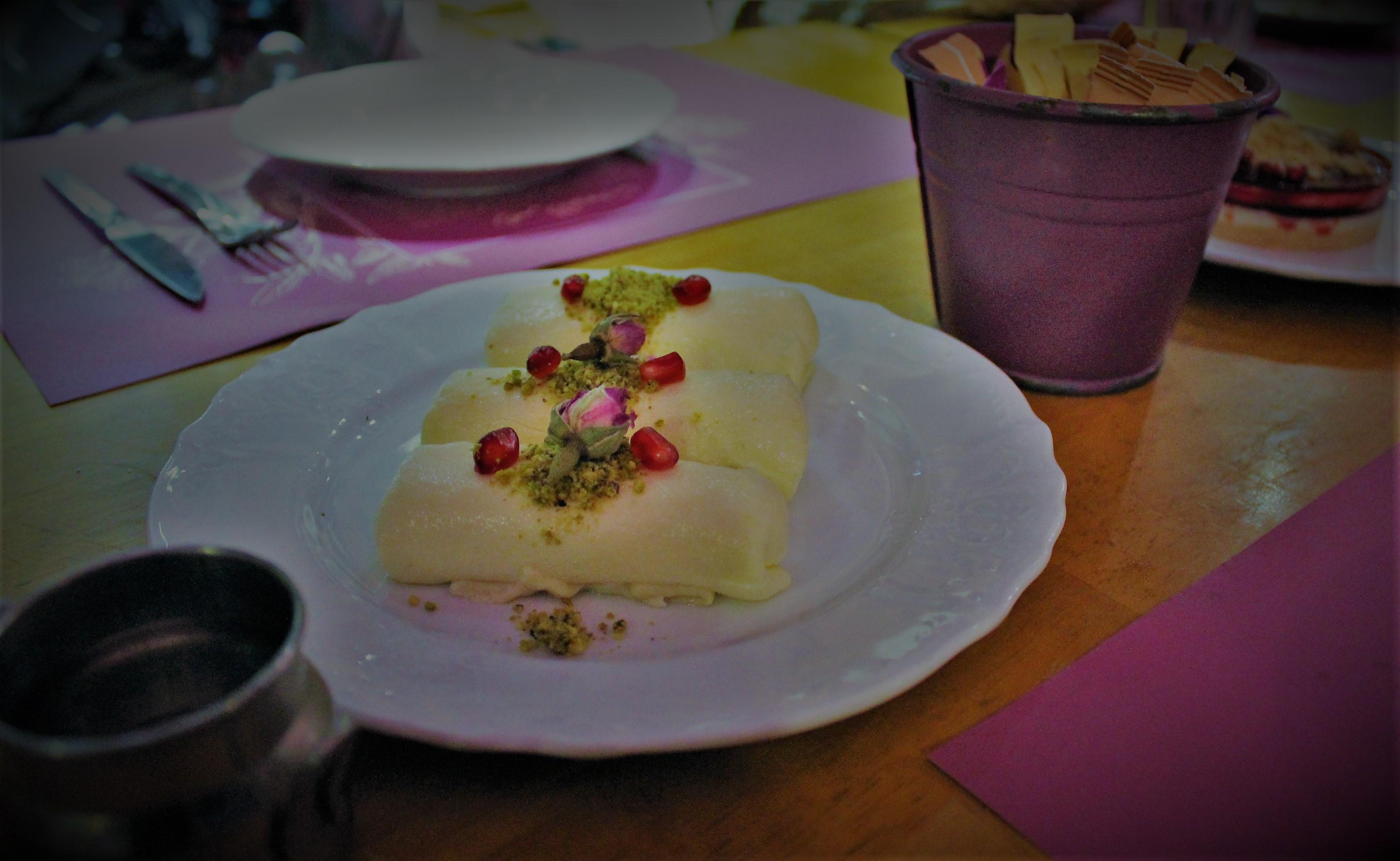 Halawat Al Jibn garnished with pistachio