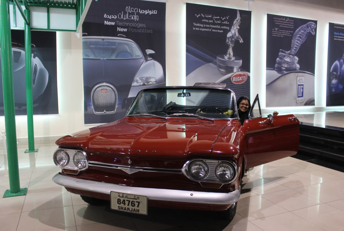 A vintage red Chevrolet Corvair convertible steals my heart at Sharjah Classic Cars Club