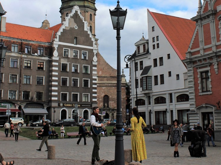 I watch a pair of Latvian musicians in their traditional clothing in Riga.