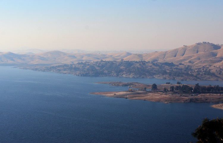 Millerton Lake is surrounded by hills which are dry now in the winter.