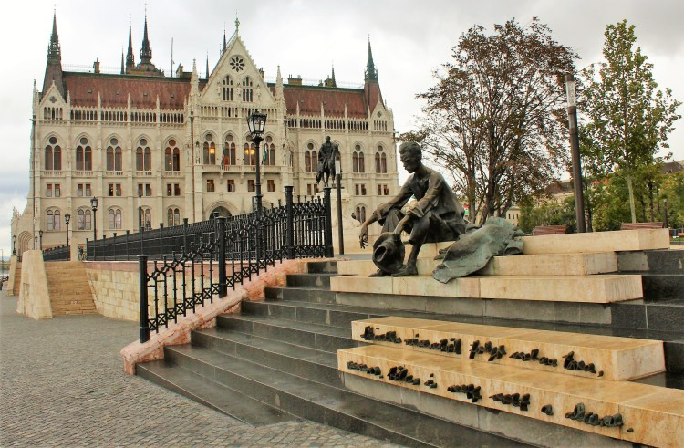 Attila Jozsef's statue sits by the Hungarian Parliament building, this Hungarian poet's lines from one of his poems raised on the steps below.