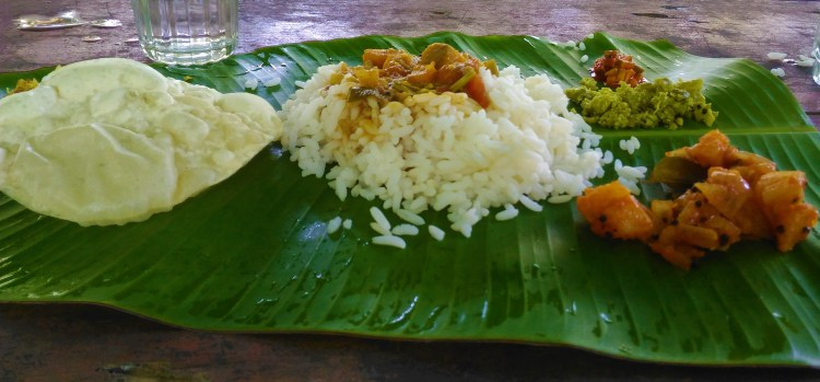 Traditional Keralite lunch served on a banana leaf.