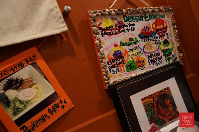 Photo Description: more artwork of Mayumi'san on her wall.