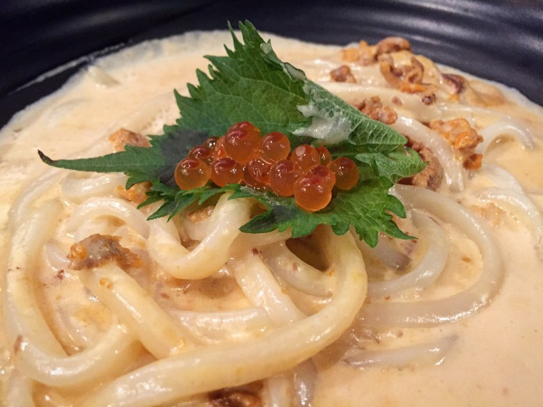 Photo Description: this is a fusion udon dish but it was very good. It's a creamy uni udon pasta topped with oba shiso.