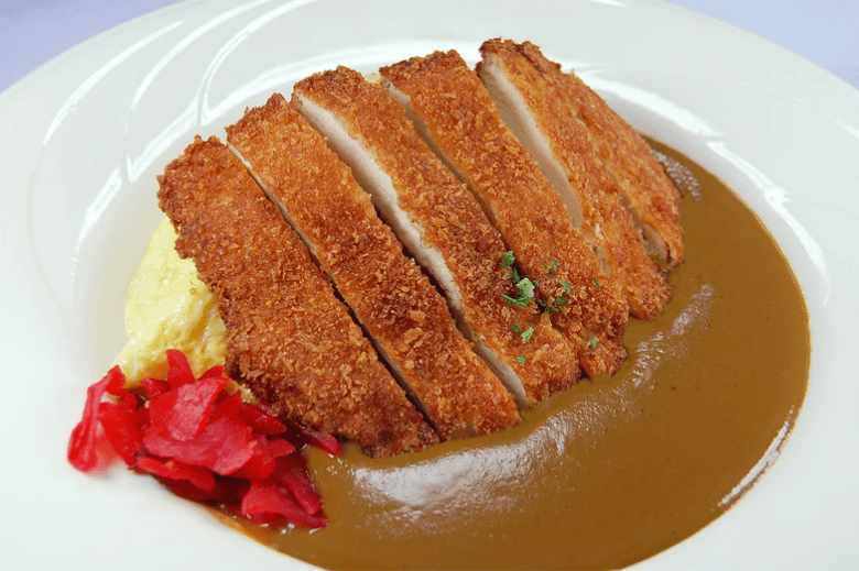 Photo Description: Japanese tonkatsu or pork cutlet with rice and Japanese curry with a side of beni shoga (pickled ginger). This dish is from Curry House.