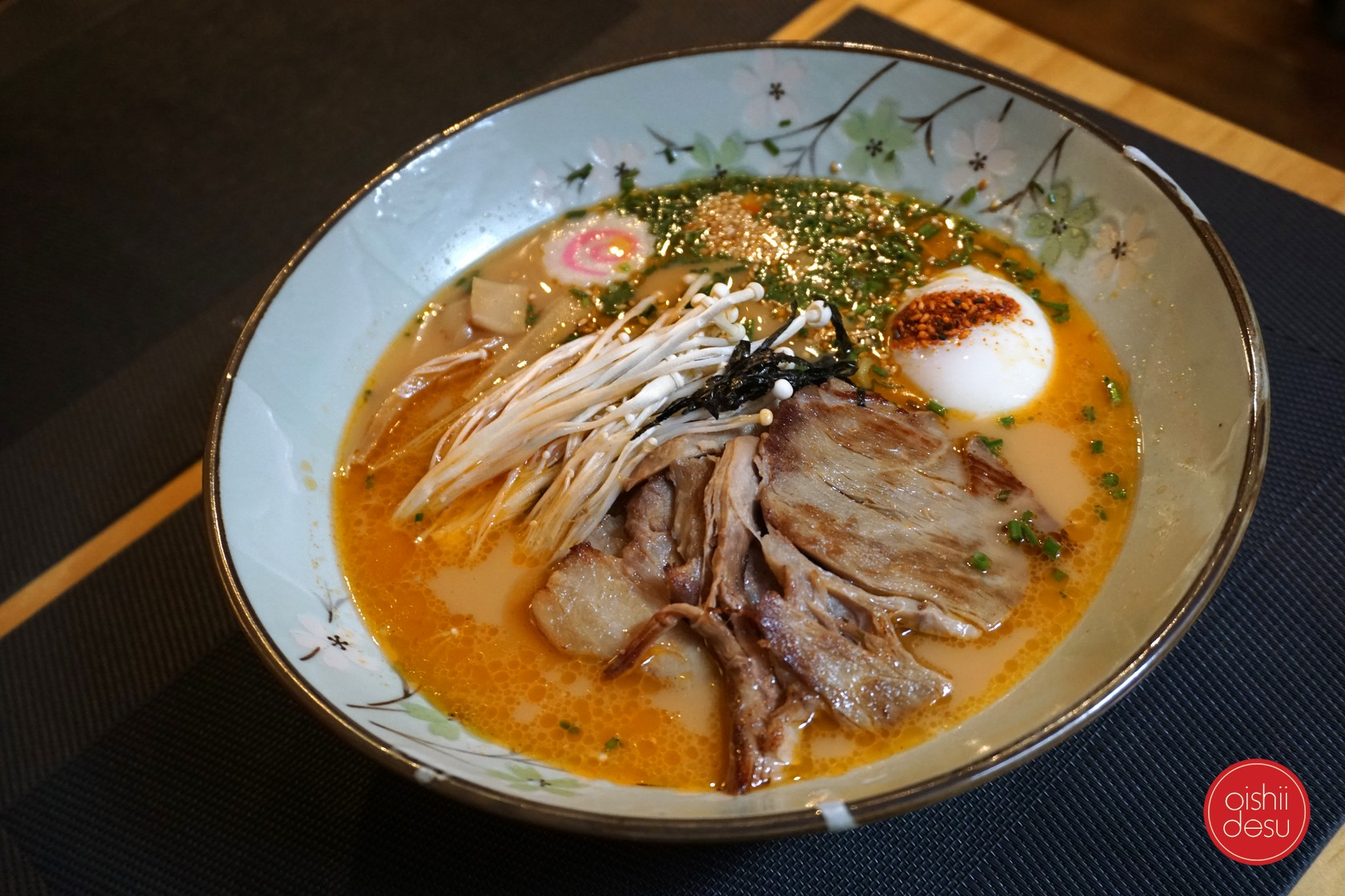 Seras tonkotsu ramen with enoki, chives, chashu, naruto, and seaweed