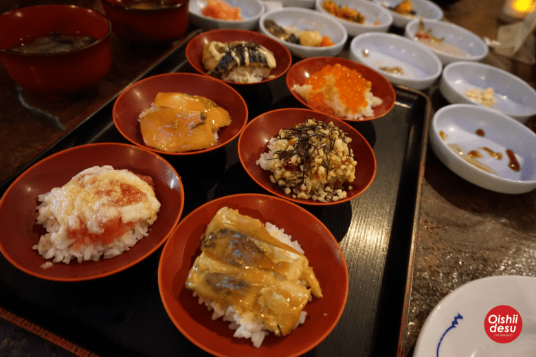 """Photo Description: the Domo spread, a number of small plates with what they call """"wanko sushi"""" which has a number of small servings of sushi instead of soba."""