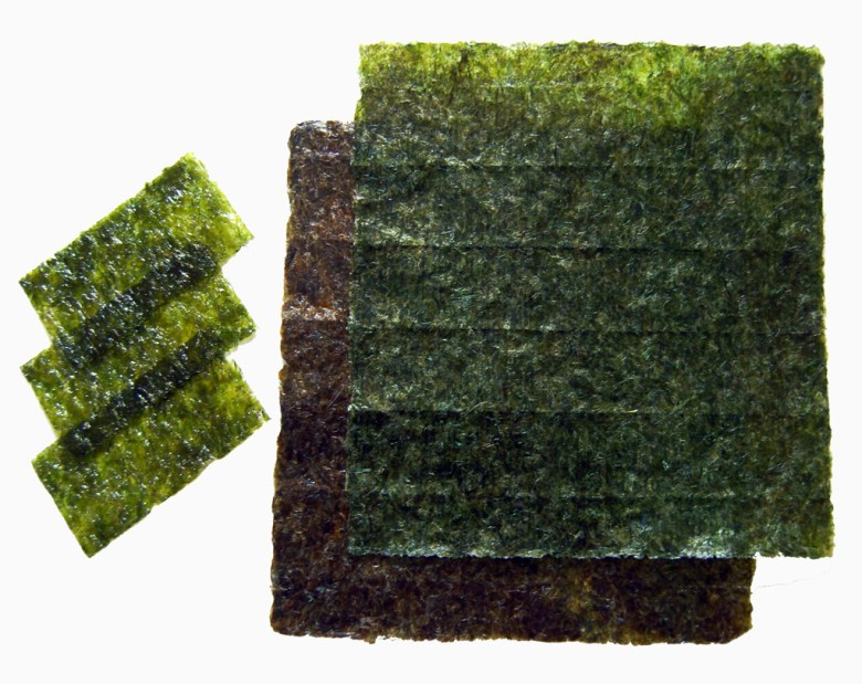 Photo Description: nori or seaweed. There are two types depicted which are strips for small bite size portions to the larger sheets used for handrolls and makizushi.