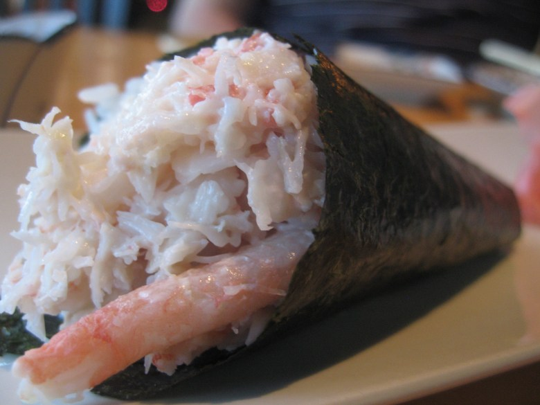Photo Description: temaki sushi hand roll. This one has what looks like fake crab along with a big sliver of real crab meat.