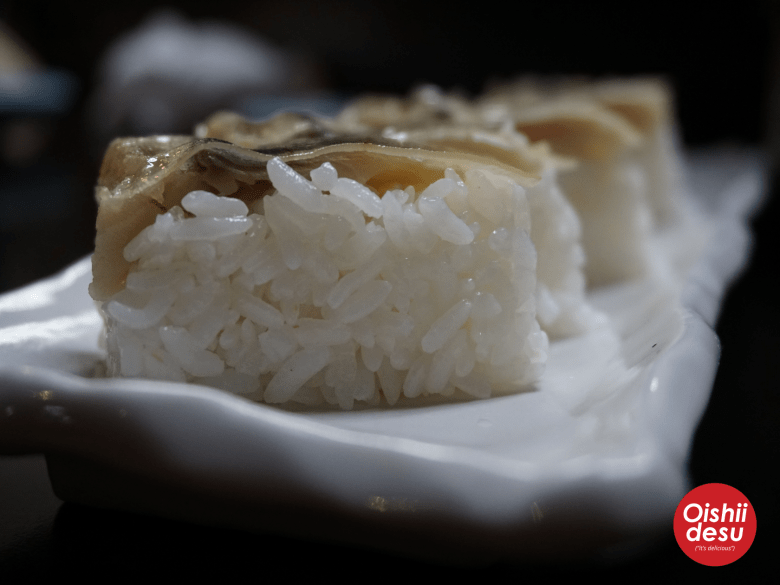 Photo Descriptions: saba battera are rectangular shaped pieces of marinated mackerel. On top of the fish is a thin layer of kombu.