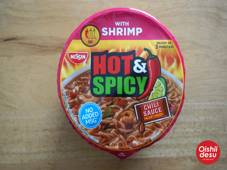 "Photo Description: Nissin Hot and Spicy Shrimp noodles.The packaging design has the text ""Hot&Spicy,"" ""with shrimp,"" ""ready in 3 minutes!,"" ""no added MSG,"" and ""chili sauce packet inside."""
