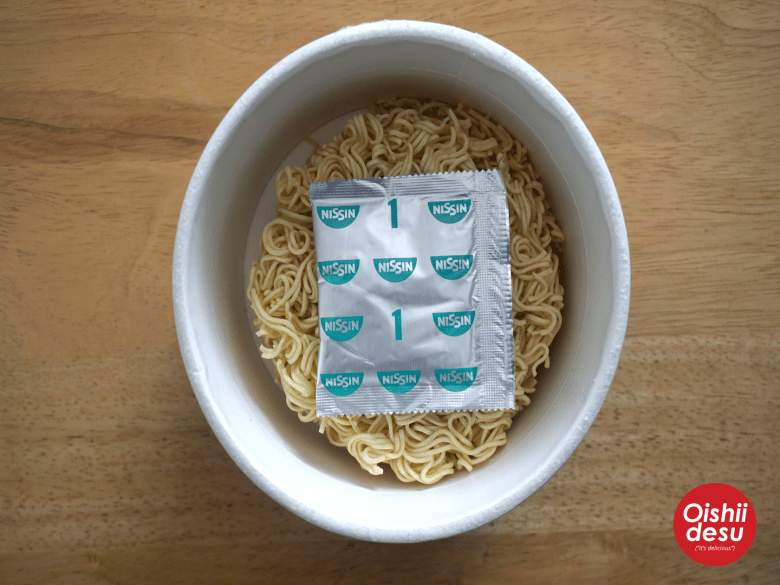 Photo Description: in this picture, the bowl, the noodles, and the spice powdered packet.