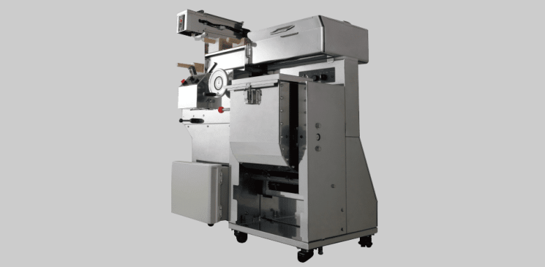 Photo Description: Yamato manufacturing, the Rich Men line of noodle maker with looks to be made of stainless steel atop 4 rollers. The machine looks fairly complex with a huge dial, compartments, and levers.