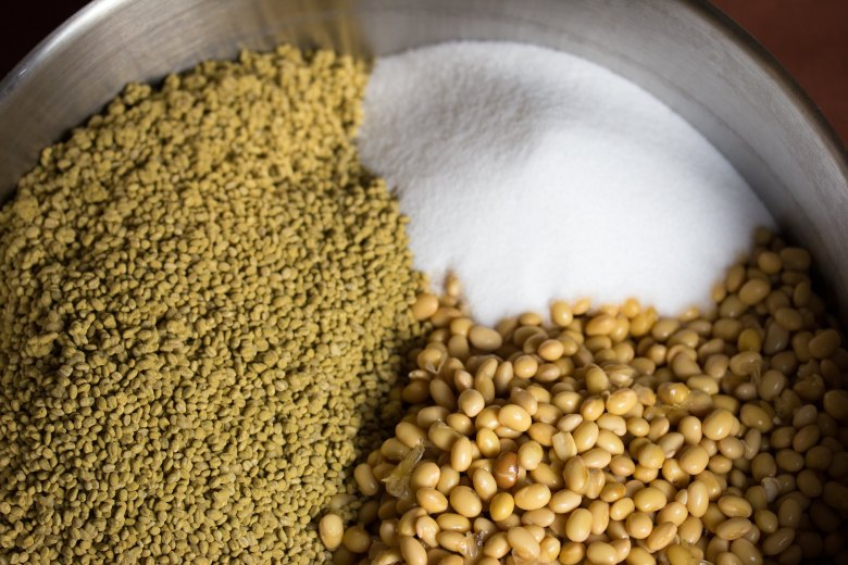 Photo Description: a somewhat close-up shot of the simple ingredients necessary to product Japanese miso which is soybeans, salt, and koji.