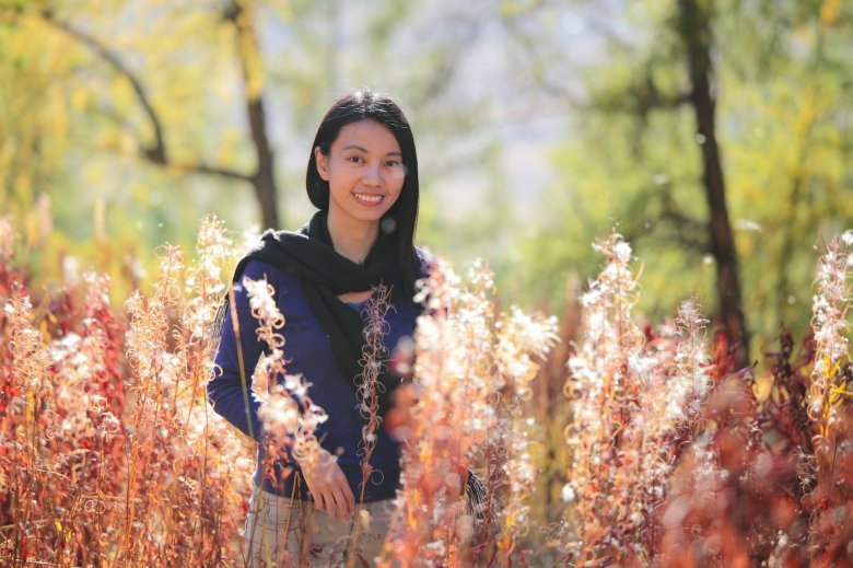 Photo Description: Kudu Momo a Flickr user has a pic of her in a field of reddish brown plants that must be a cotton field.
