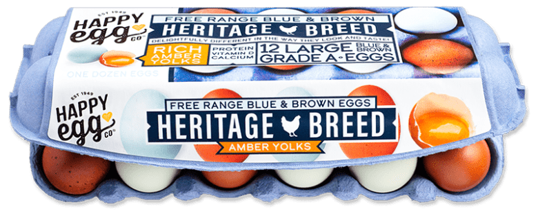 """Photo Description: an egg crate of eggs by Happy Egg. The text on the packaging says """"free range blue and brown eggs, Heritage Breed, amber yolks."""""""