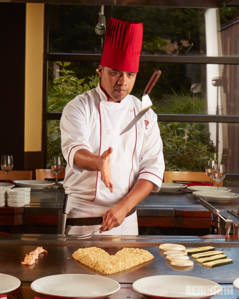 Photo Description: one of the chefs at Benihana in the good ole US of A. On the teppanyaki the fried rice is shaped in the shape of a heart.
