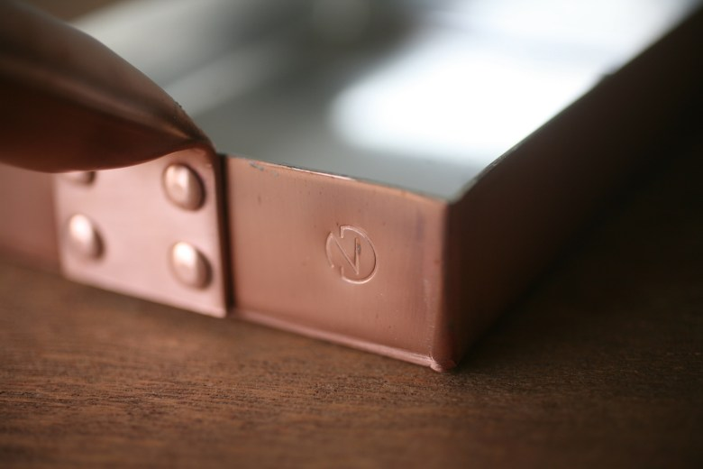 "Photo Description: The details of the Nakamura copper tamagoyaki pan. In the rear righ-side of the pan is the stamp logo of an ""N"" for Nakamura in romaji."