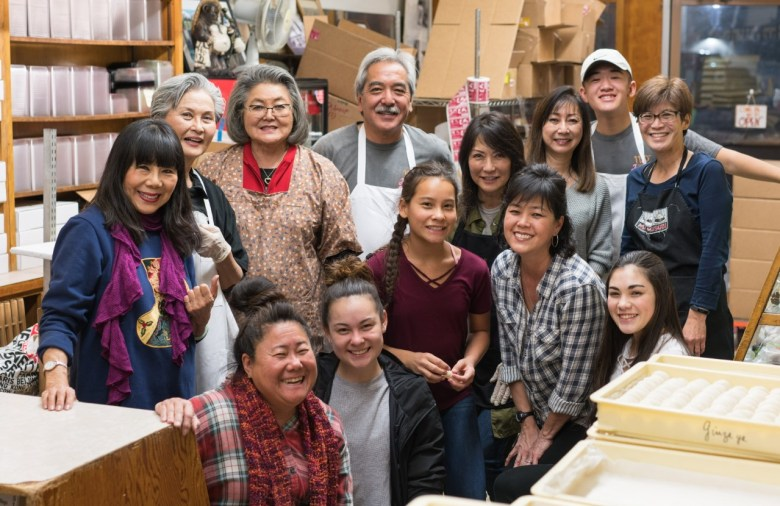 """Photo Description: the """"mochi madness"""" crew at Fugetsu-do which is a pic that probably covers at least 4 generations of family and staff."""