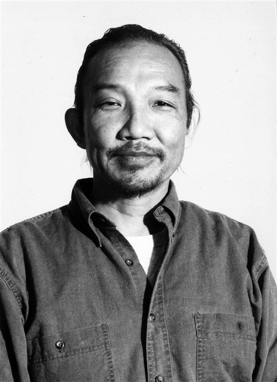 Photo Description: Steve Kiyoshi Kuromiya looks sort of high in this shot and he just might be. This image is of him in his later years although he died fairly young at only 57 years old of HIV/AIDS.