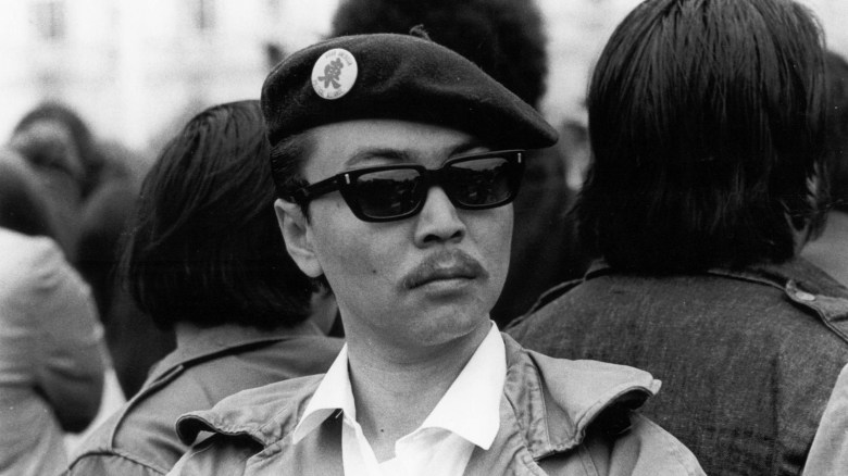 Photo Description: what a cool pic which is of Richard Aoki in a beret and some sunglasses looking like  badass.