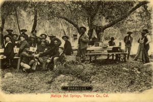 Old postcard showing early United States Forest Service rangers gathered for a barbeque at Matilija Hot Springs which is only a few miles outside of the Ojai Valley in Ventura County, California.