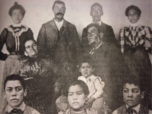 "The Reyes family circa 1897. (Howard Bald collection, courtesy of OVM). Jacinto Damien Reyes, (third row, second from left) retired in Ojai in the 1930s after three decades as a forest ranger, explorer, and trail-maker in the Sespe wilderness. Reyes Peak, rising 8400 feet in the Cuyama, is named fro him. A hero in the great Matilija-Wheeler Canyon fire of 1917, Reyes also did much to redeem the reputation of the ""badlands"" along the old Maricopa road from the legendary bandido gangs. The son of Don Rafael Reyes and Dona Maria Ortega (pictured here, second row) Jacinto Reyes grew up on a ranch in Cuyama, now part of the Los Padres National Forest. Presidents William McKinley and Theodore Roosevelt visited the Reyes Ranch in 1901 and 1905. The family is descended from Francisco Reyes, original holder of the San Fernando Valley land grant in the 1780s, and the equally illustrious Ortegas of Ventura County."