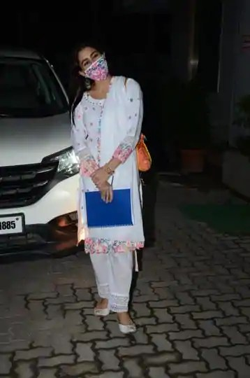 Sara Ali Khan's white outfit with rainbow coloured accents, matching accessories and mask is a lockdown Diwali wardrobe must-have