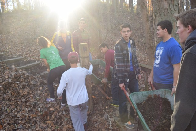 Students begin the trek from mulch pile to trail.