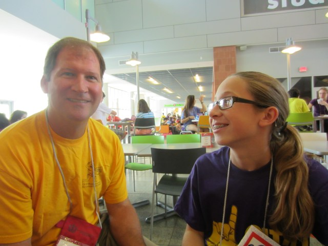 Julia gazes lovingly at her father.