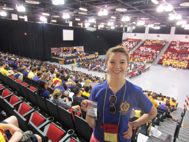 Regina and her award, from the back row of the auditorium, with nice view of the delegates and stage,