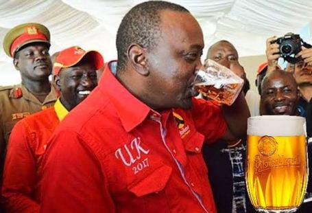 President Of Kenya H.E Uhuru Kenyatta gulping his favourite drink, beer.