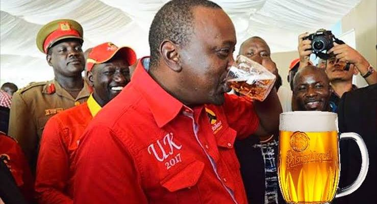 President Of Kenya H.E Uhuru Kenyatta gulping his favourite drink, beer.