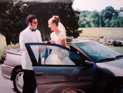 Making a very loud entrance at our wedding reception, 2002