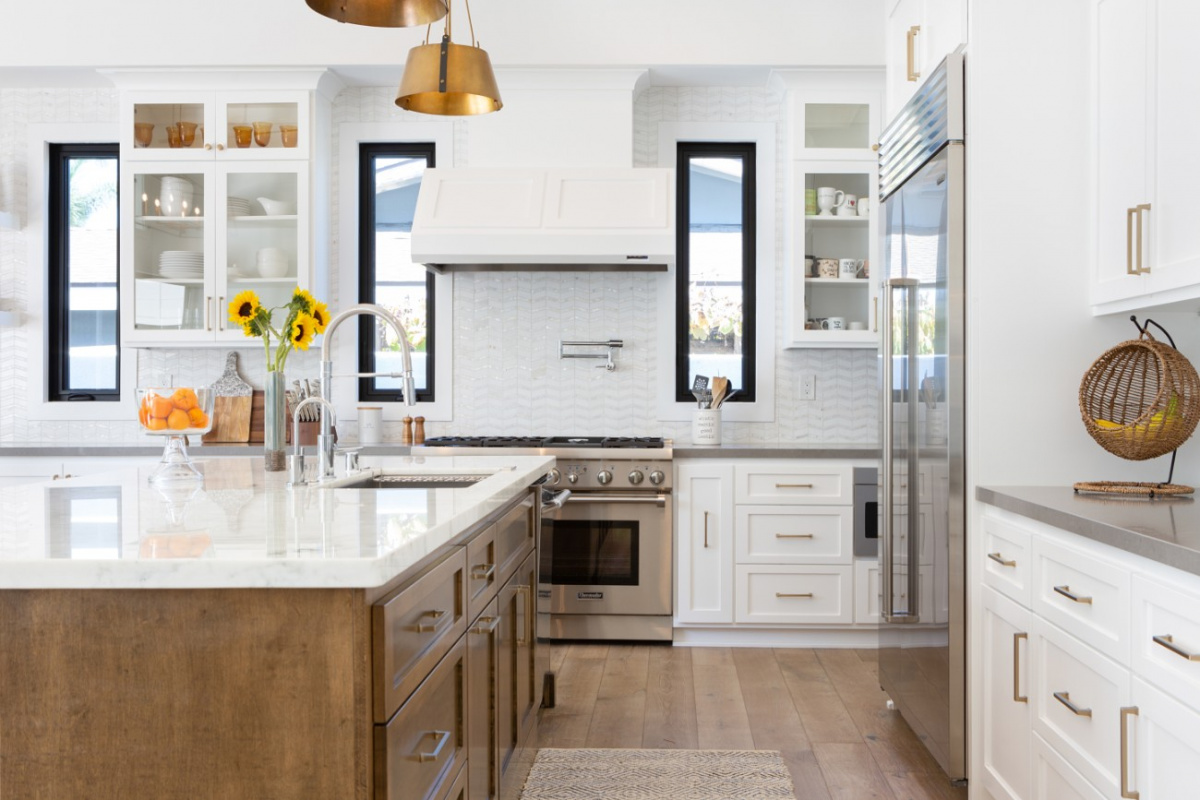 White countertop kitchen island with built in sink.