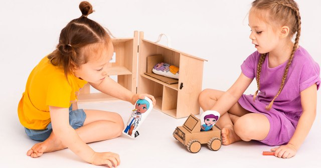 OKMinis being played with in a Holdie House with cardboard car
